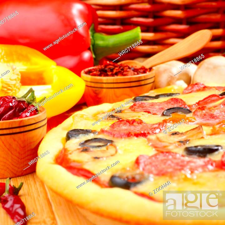 Stock Photo: Pizza on the table.