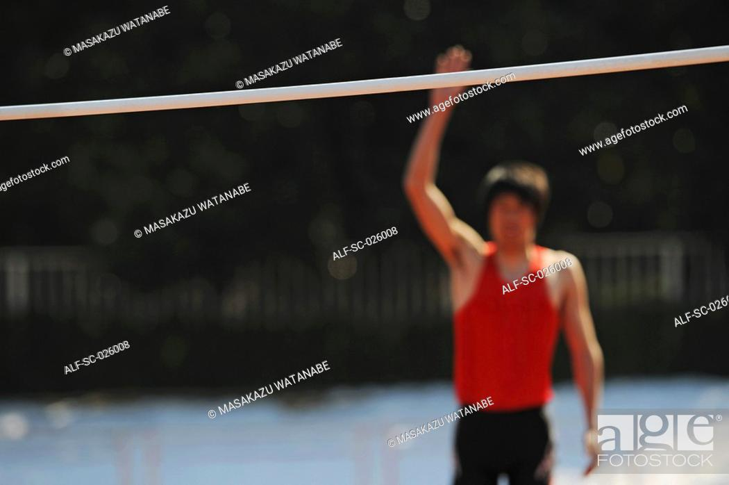Stock Photo: Athlete Preparing to Jump.