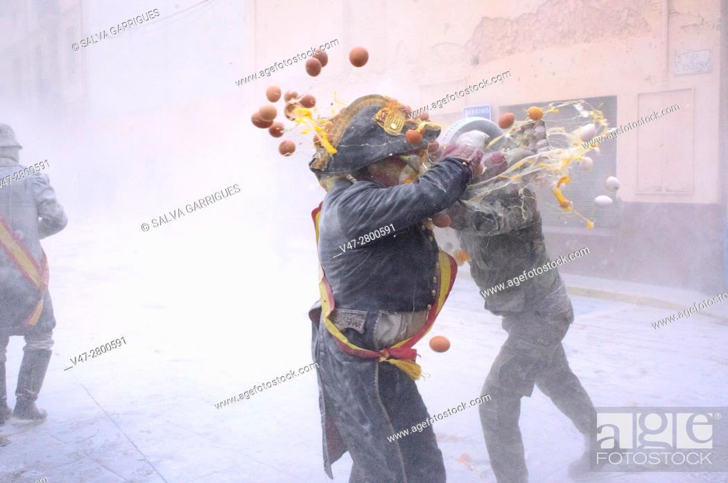 Stock Photo: The party of Els Enfarinats (The floured ones), The inhabitants of Ibi make a war with eggs and firecrackers every December 28, Alicante, Valencia, Spain.