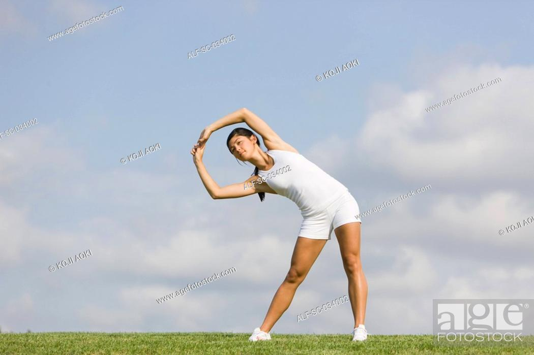 Stock Photo: Woman Exercising and stretching arms.