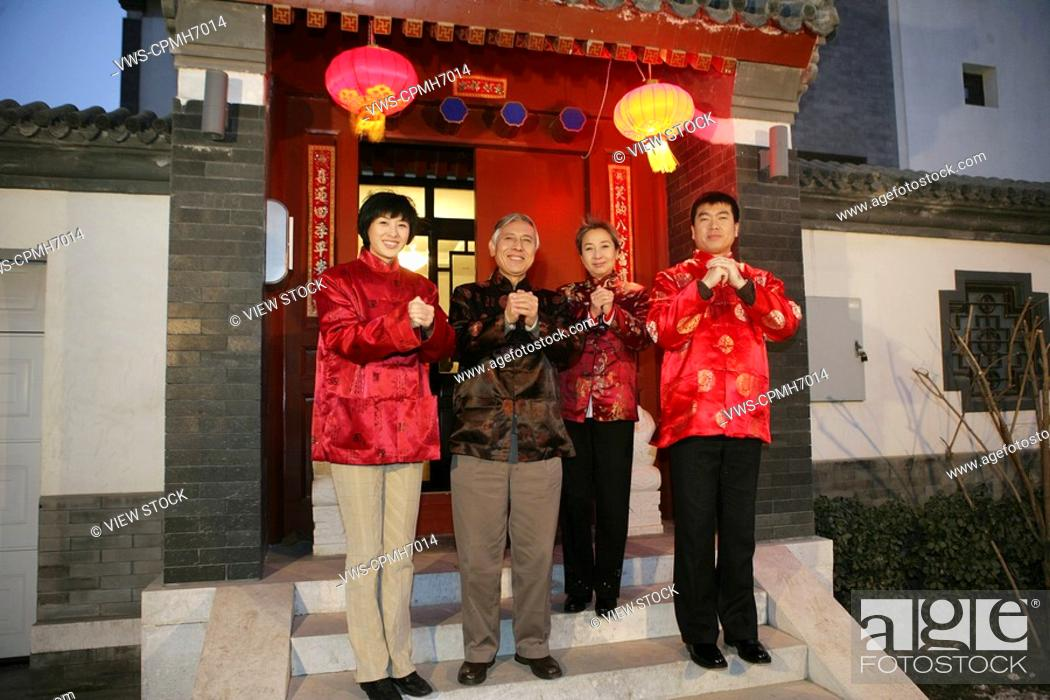 Stock Photo: Chinese family making a wish with hands clasped.