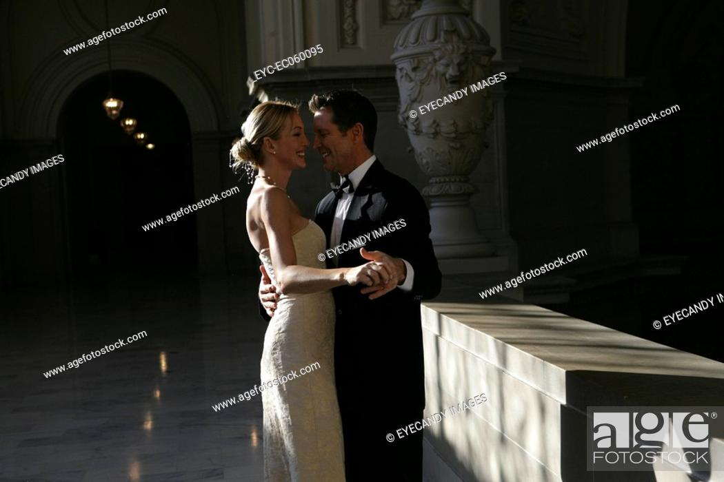Stock Photo: Mature couple dancing, looking into each others eyes.
