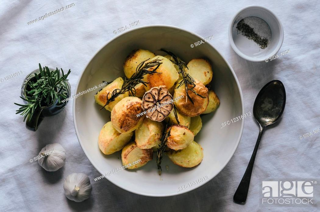 Stock Photo: Potatoes with garlic and rosemary (top view).