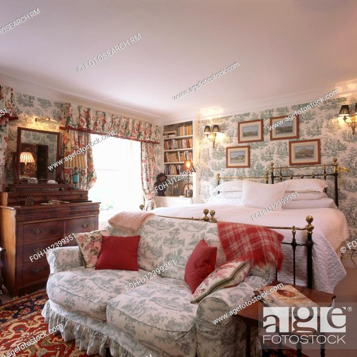 Stock Photo: Toile De Jouy Sofa In Comfortable Bedroom With Wallpaper And  Pictures