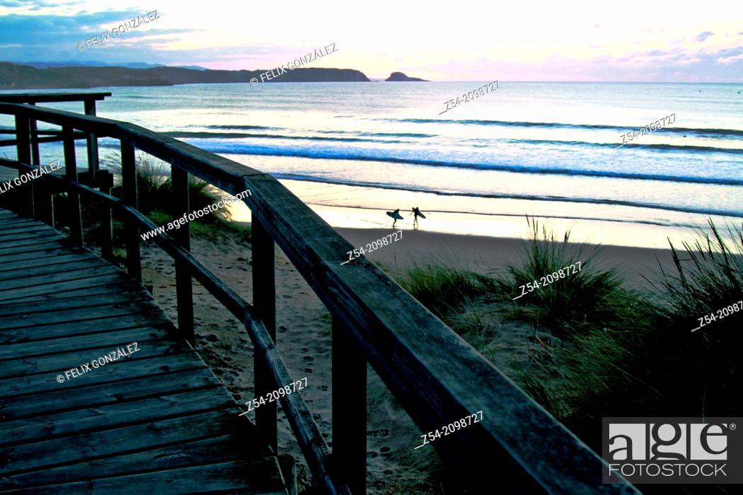 Stock Photo: Couple pof surfers at El Espartal dune, Asturias Spain.
