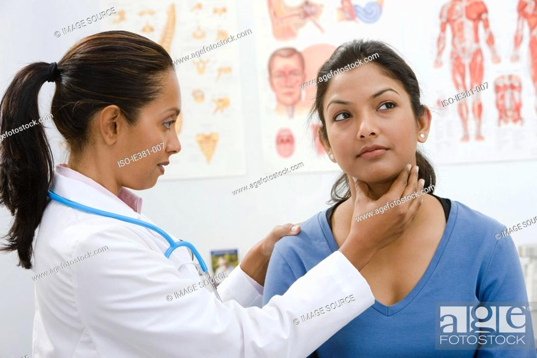 Stock Photo: A doctor examining woman.