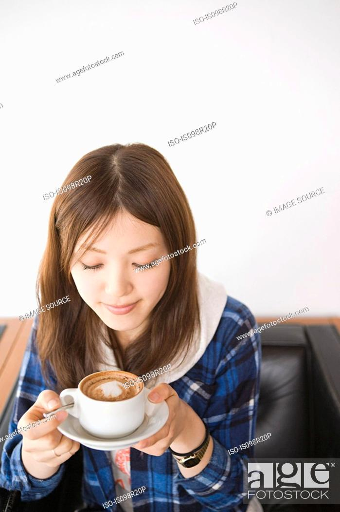 Stock Photo: Young woman with cappuccino.