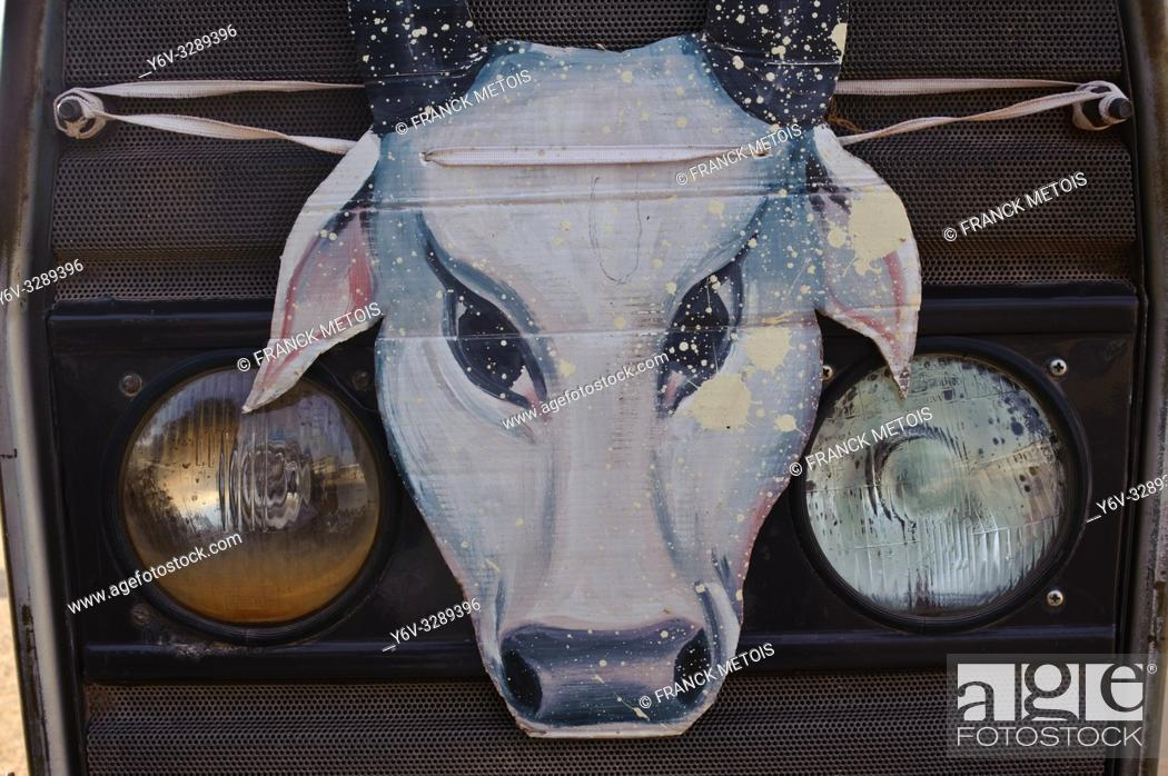 Stock Photo: Image representing a cow's head ( India). It is attached to the grille of a tractor. The cow's head is a symbol used by hindu nationalists.