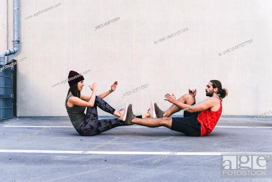Stock Photo: Fit young couple doing partner exercises.