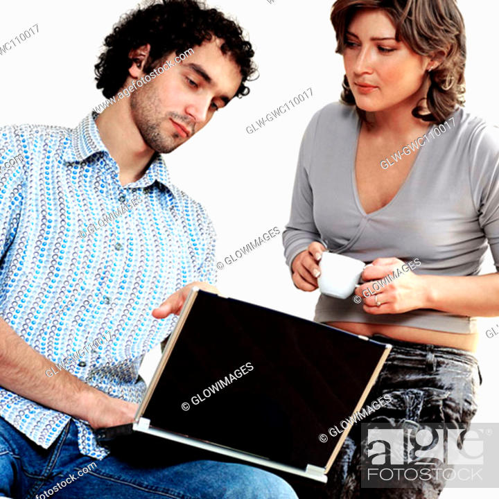 Stock Photo: Young couple working on a laptop.