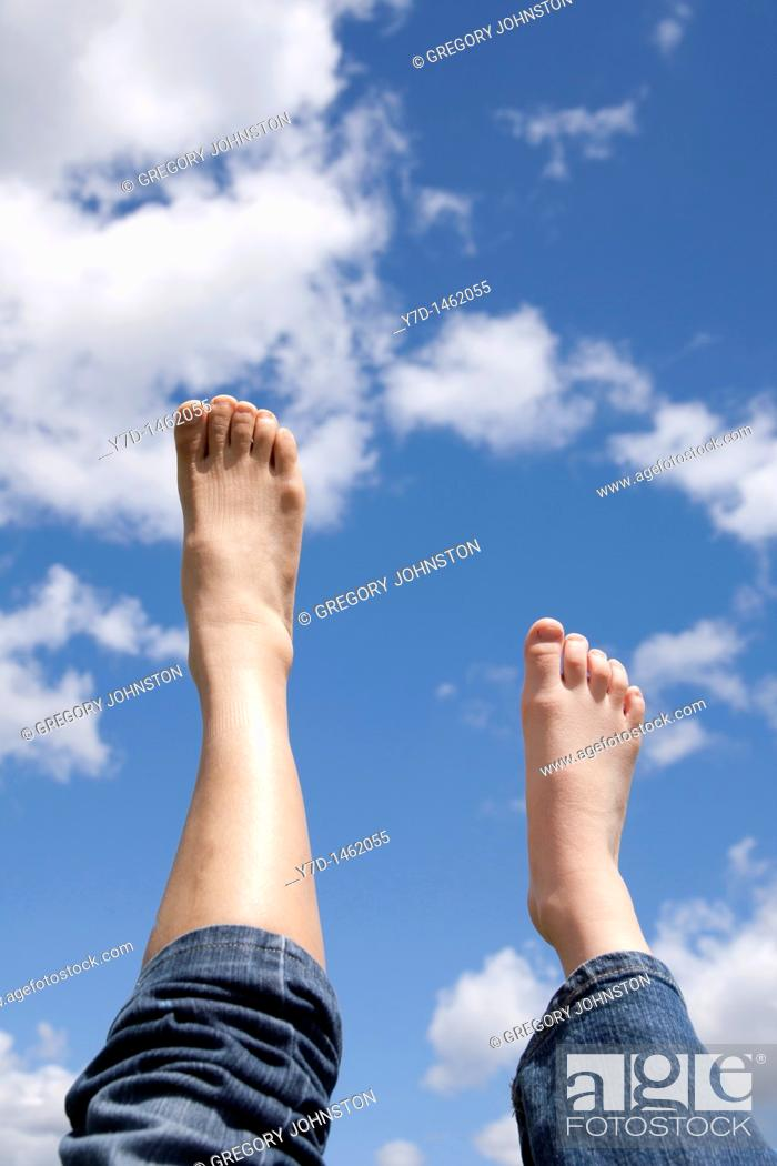 Stock Photo: Putting their right foot forward or in this case, upward.