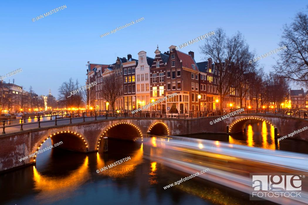 Stock Photo: Evening view of bridges crossing the Keizersgracht, canal in Amsterdam The Netherlands.