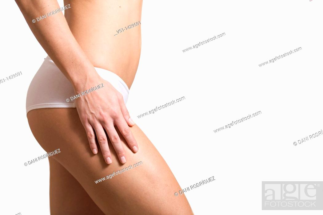 Stock Photo: Woman's buttock and legs.