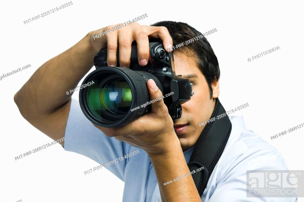 Stock Photo: Photographer taking a picture with a digital camera.