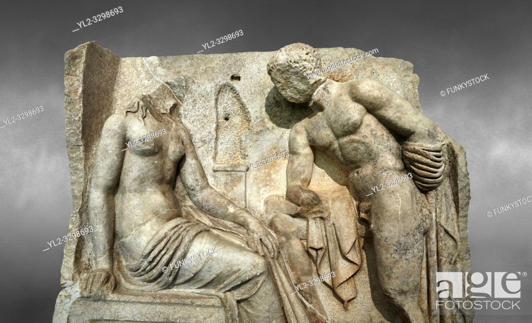 Stock Photo: Close up of a Roman Sebasteion relief sculpture of Io and Argos Aphrodisias Museum, Aphrodisias, Turkey. Against a grey background. .