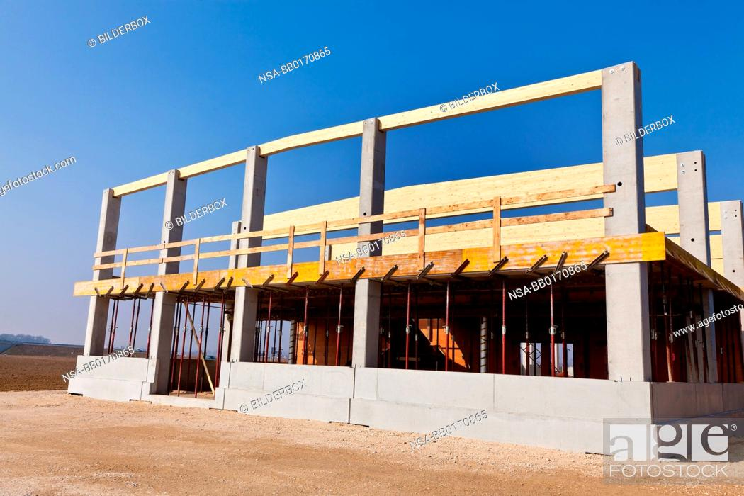 Stock Photo: A building for warehousing and production is established.Commercial construction site.