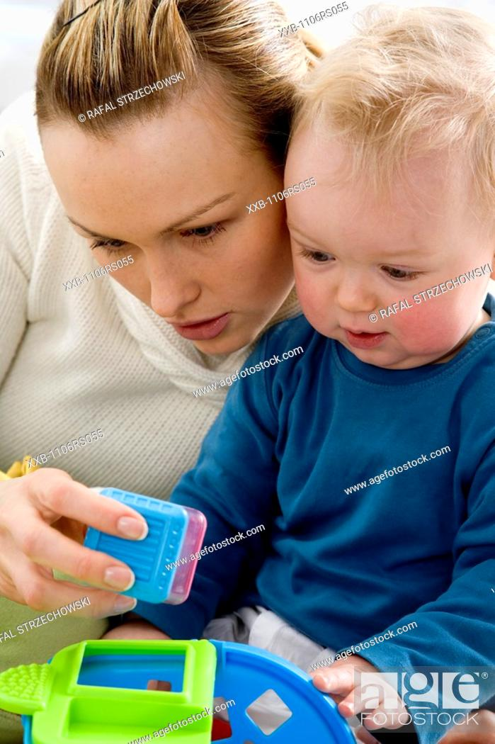 Stock Photo: mum playing with son.