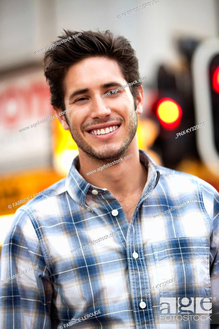Stock Photo: Close-up of a handsome man smiling.