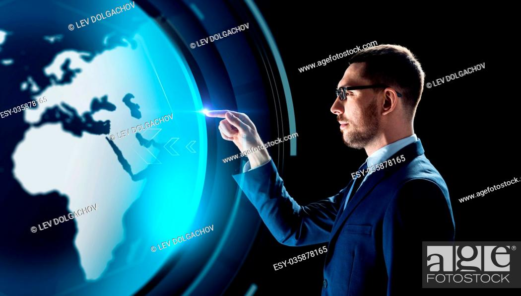 Stock Photo: business, people, augmented reality and future technology concept - businessman with virtual earth hologram over black background.