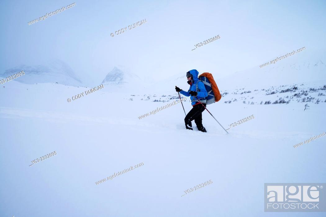 Stock Photo: Female nordic ski tourer in deep snow near Kebnekaise Fjällstation, Lapland, Sweden.