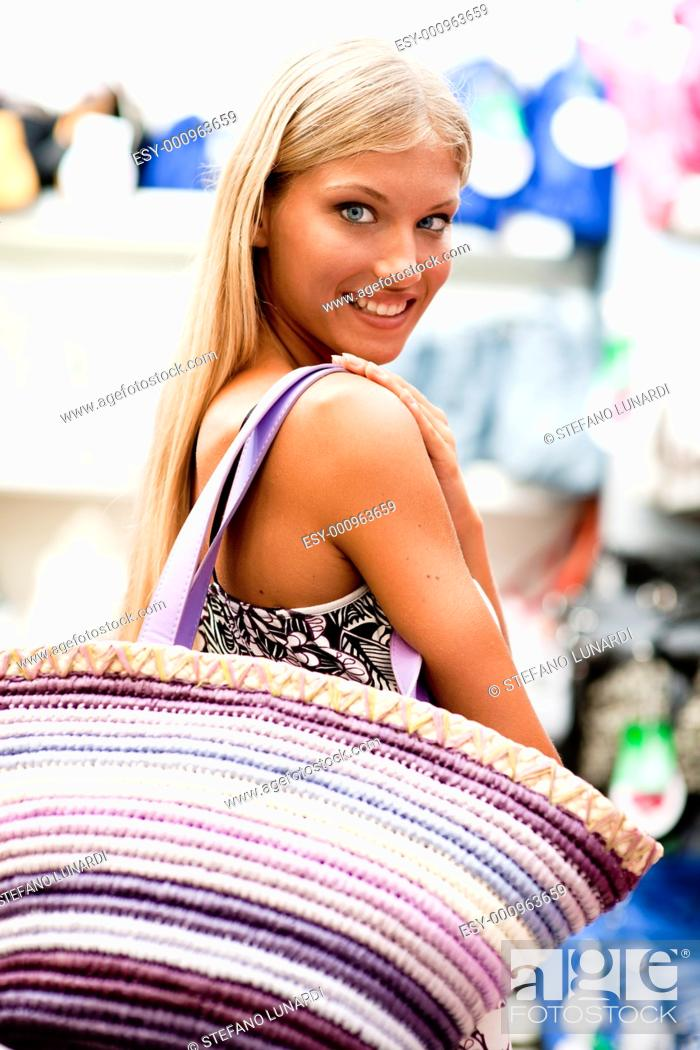 Stock Photo: Beautiful young woman doing shopping.