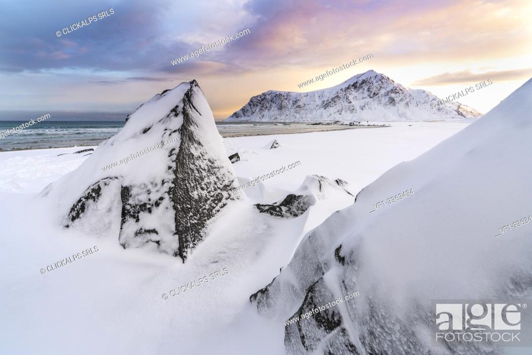 Stock Photo: Skagsanden beach at dawn in winter, with rocks in the foreground. Flakstad, Nordland county, Northern Norway, Norway.
