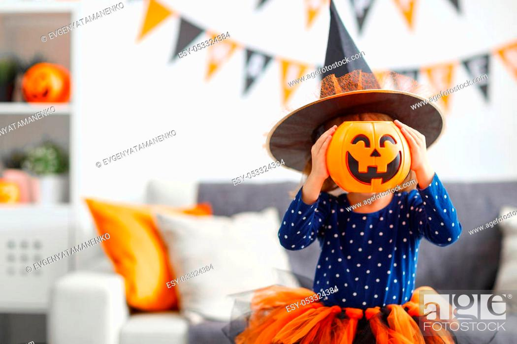 Stock Photo: happy laughing child girl in witch costume to halloween.