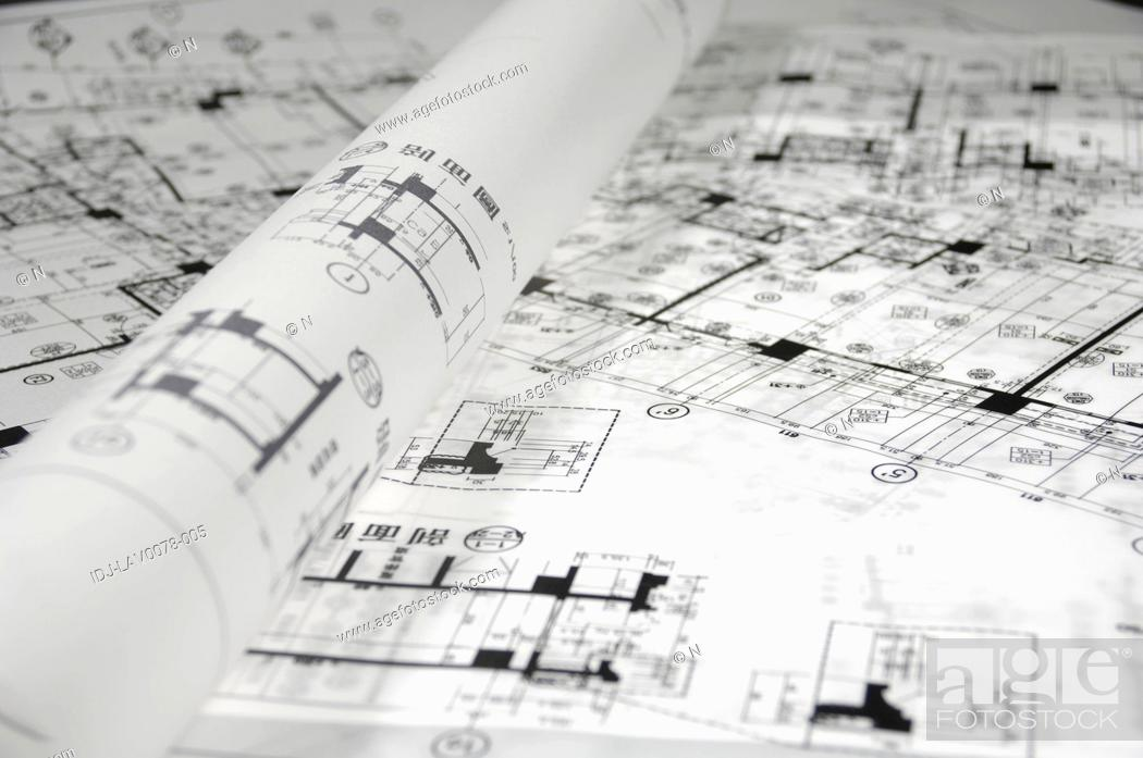 Stock Photo: Close-up of blueprints in an office.