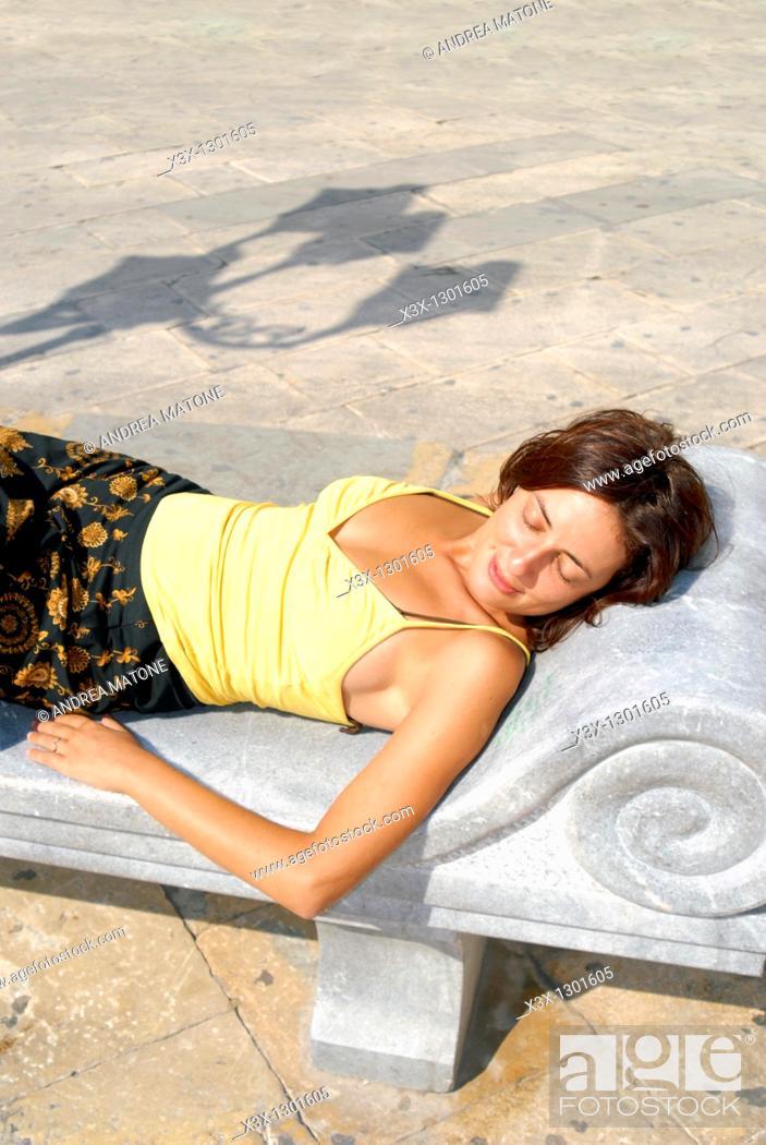 Stock Photo: Sunbathing in the town of Marsala Sicily Italy.
