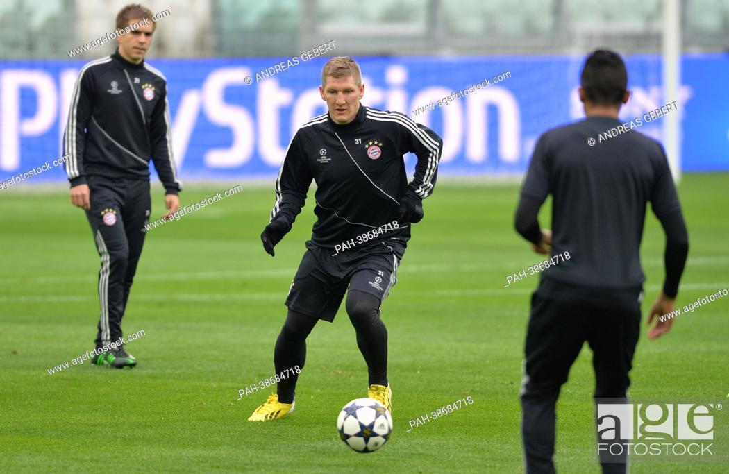 Philipp Lahm (L-R) and Bastian Schweinsteiger of FC Bayern