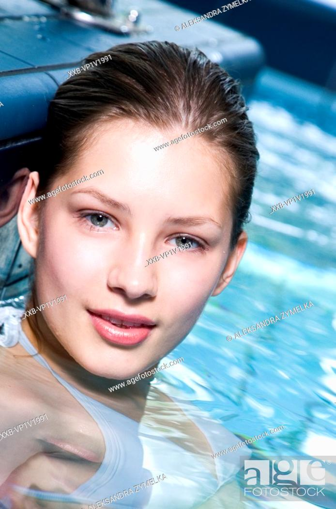 Stock Photo: young woman in the swimming pool.