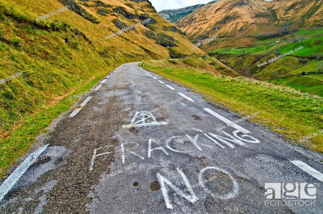 """Stock Photo: Anti-fracking slogan """"""""No to fracking"""""""" spraypainted on a mountain road in the Cantabrian mountains near the city of Santander."""