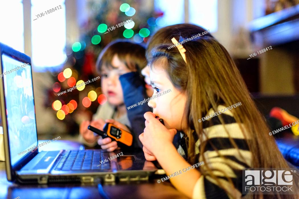 Stock Photo: Children watch a DVD on the laptop.