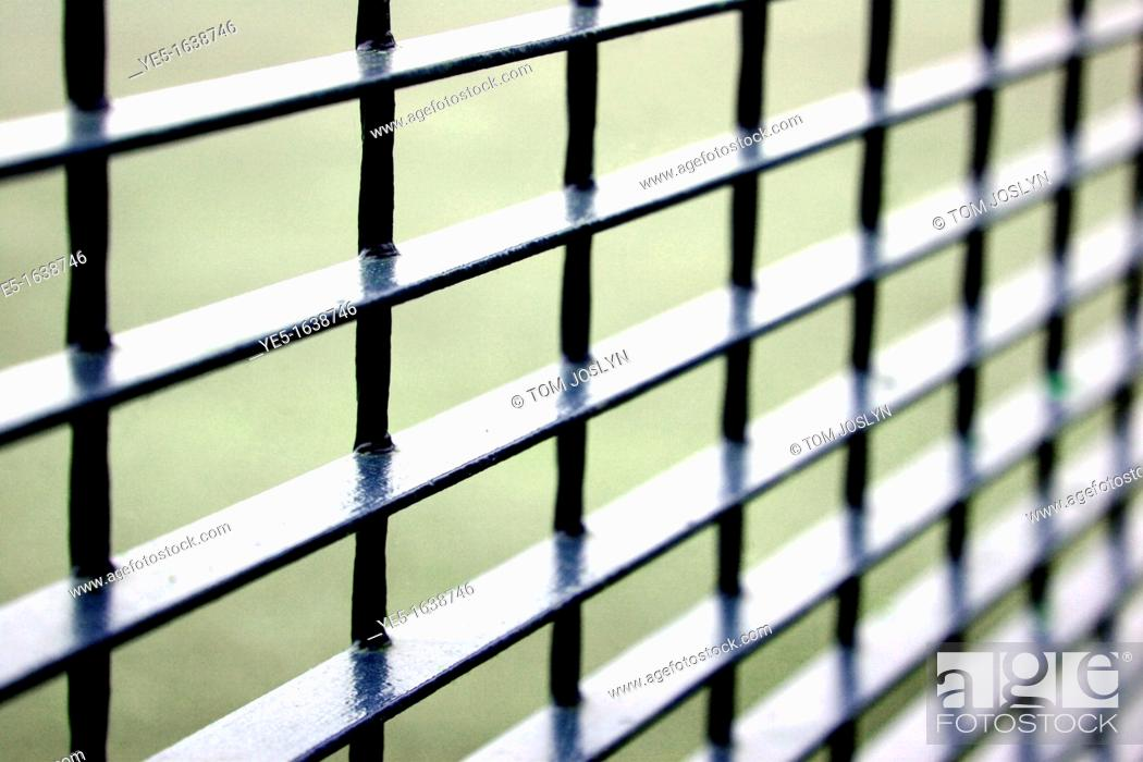 Stock Photo: Metal fence detail close up.