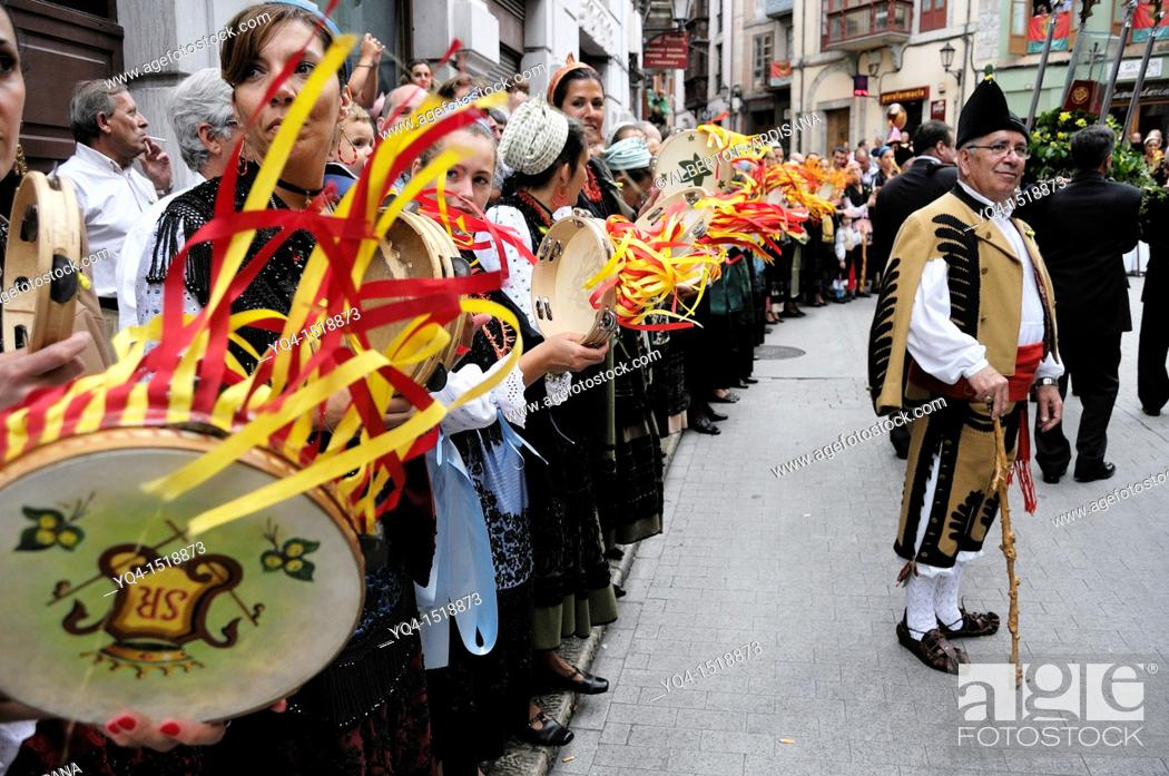Stock Photo: A man dressed in traditional costume of Llanes, with women who play the tambourine during the arrival of the procession to the chapel of San Roque, Llanes.
