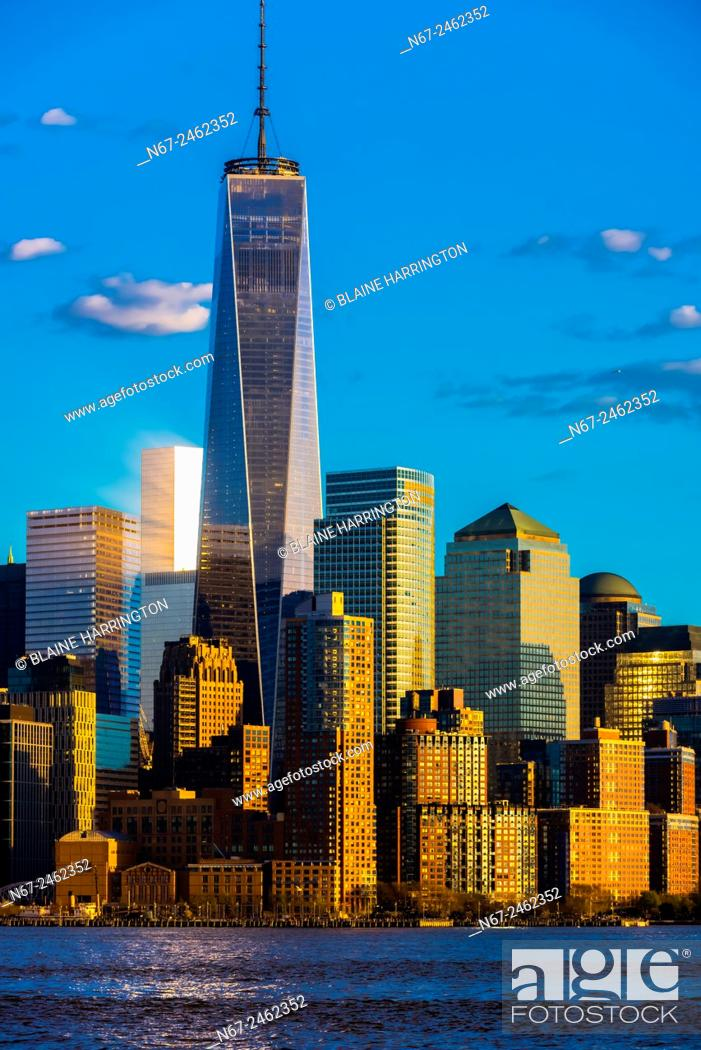 Stock Photo: One World Trade Center (tallest skyscraper in the Western Hemisphere and fourth tallest in the world) towers over other buildings in Battery Park City, New York.