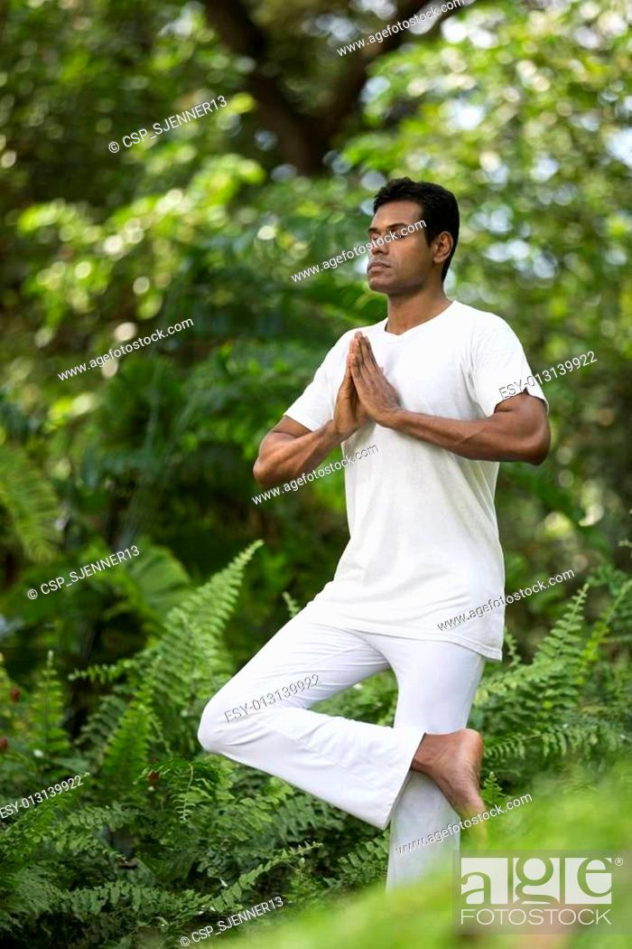 Indian Man Doing Yoga Exercise In A Forest Stock Photo Picture And Low Budget Royalty Free Image Pic Esy 013139922 Agefotostock