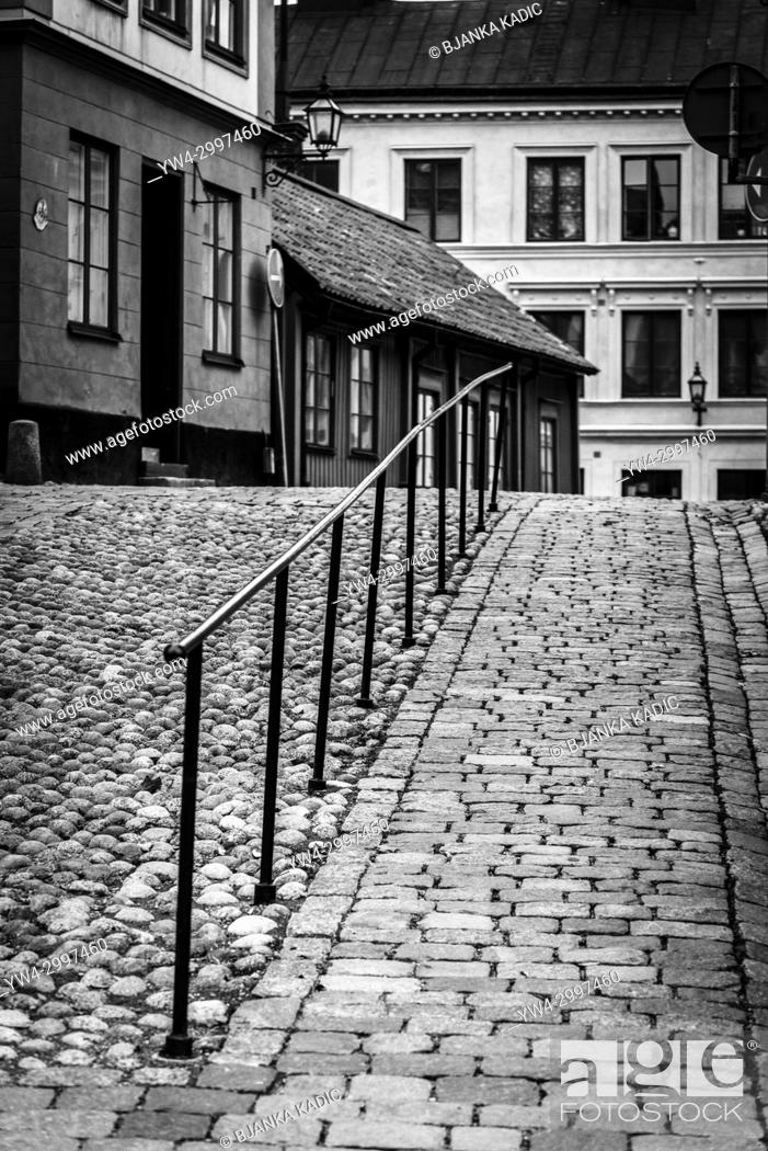 Stock Photo: Cobbled hilly street with traditional houses in Sodermalm, Stockholm, Sweden.