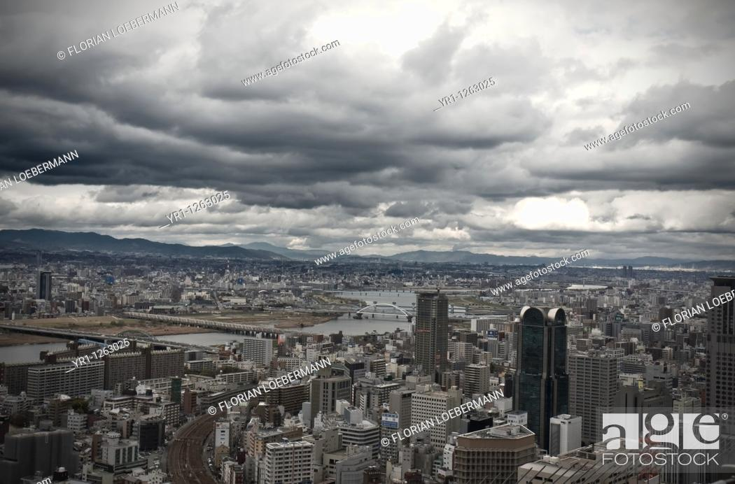 Stock Photo: Stormy clouds over the city of Osaka, Japan. Bridges are crossing river yodo.