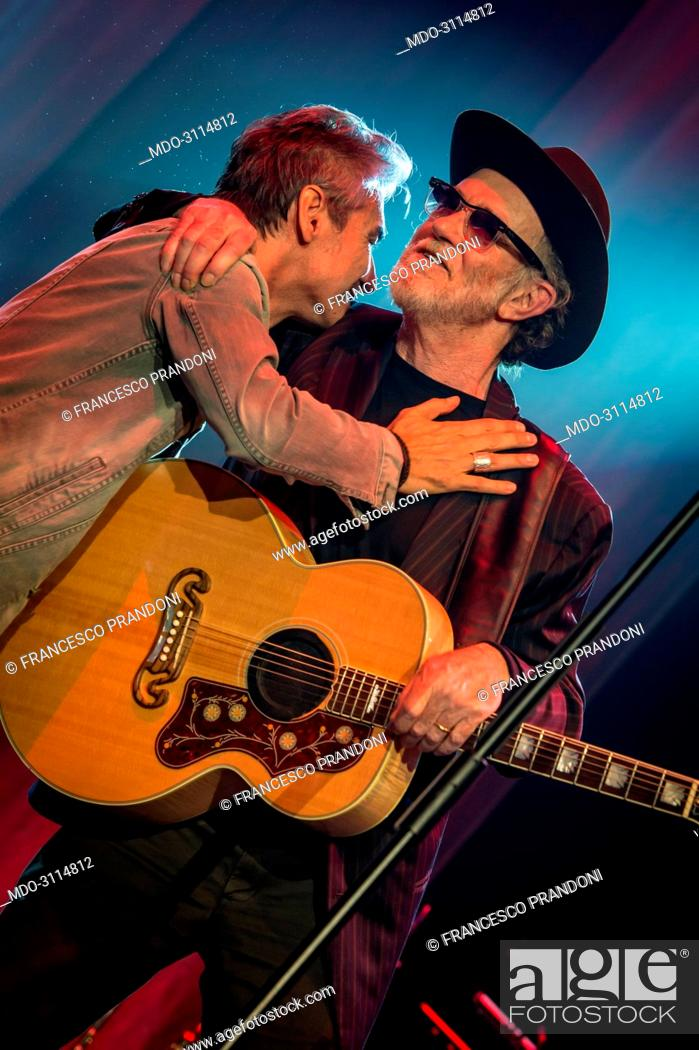 Italian singer songwriters luciano ligabue and francesco de gregori stock photo italian singer songwriters luciano ligabue and francesco de gregori hugging and greeting each other during de gregoris concert at mediolanum m4hsunfo