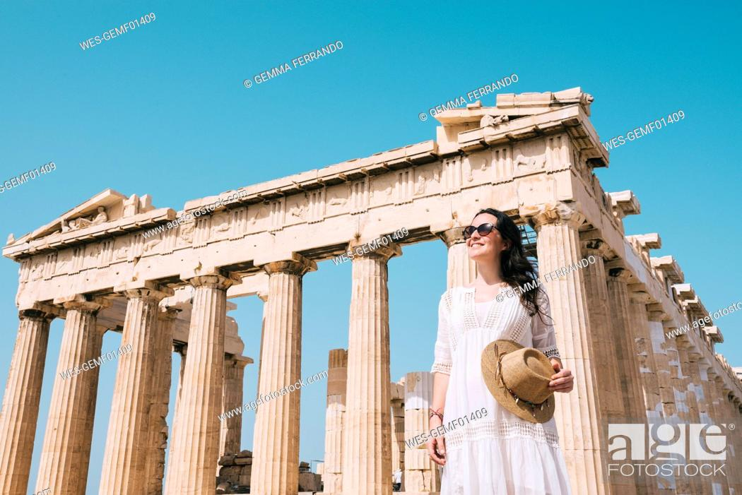 Stock Photo: Greece, Athens, smiling woman visiting the Parthenon temple on the Acropolis.
