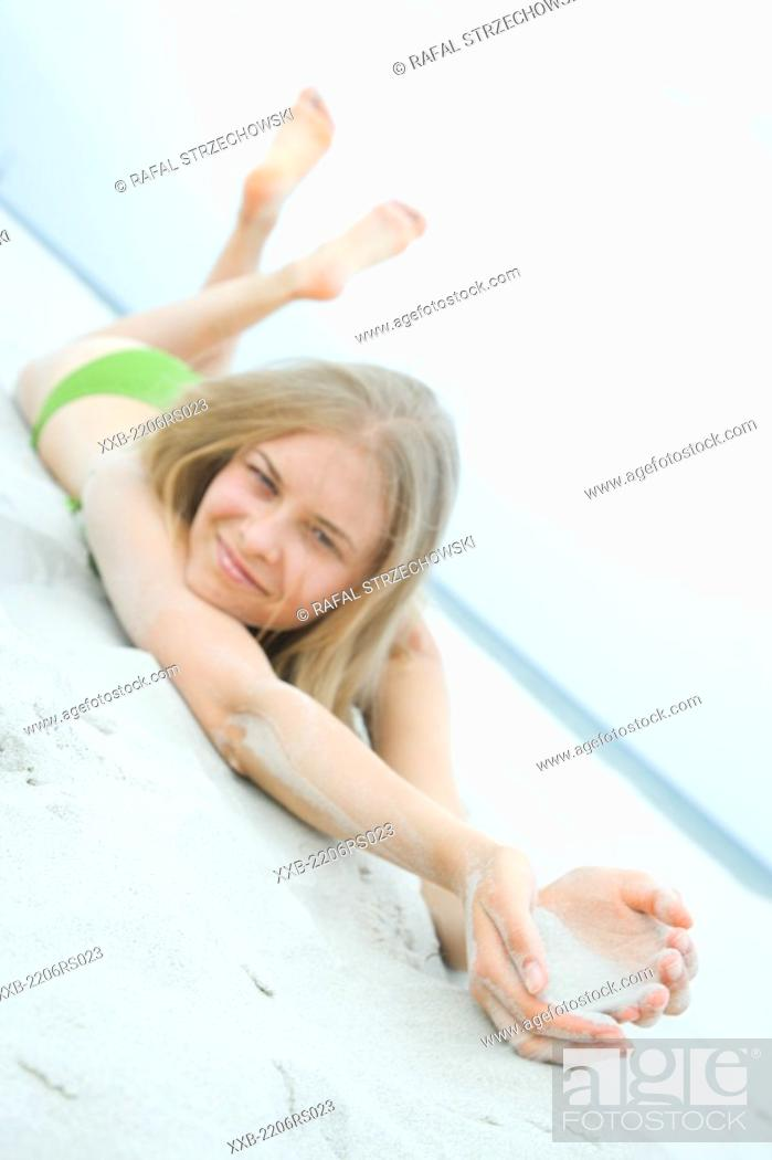 Stock Photo: smiling woman lying on beach.