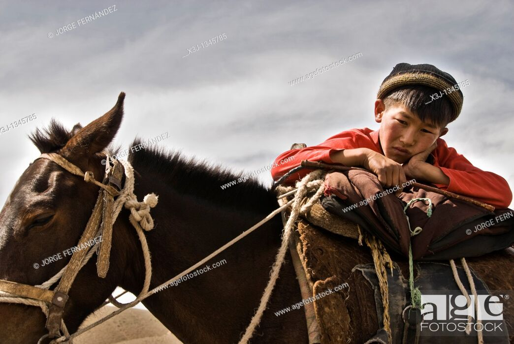 Stock Photo: Boy on his horse, Kyrgyzstan.