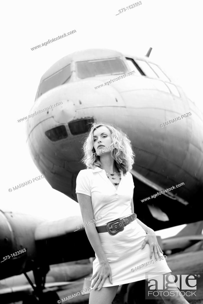 Stock Photo: Sensual woman next to a plane.