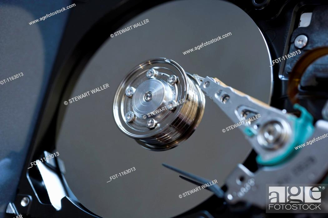 Stock Photo: Detail of inside of computer hard drive.