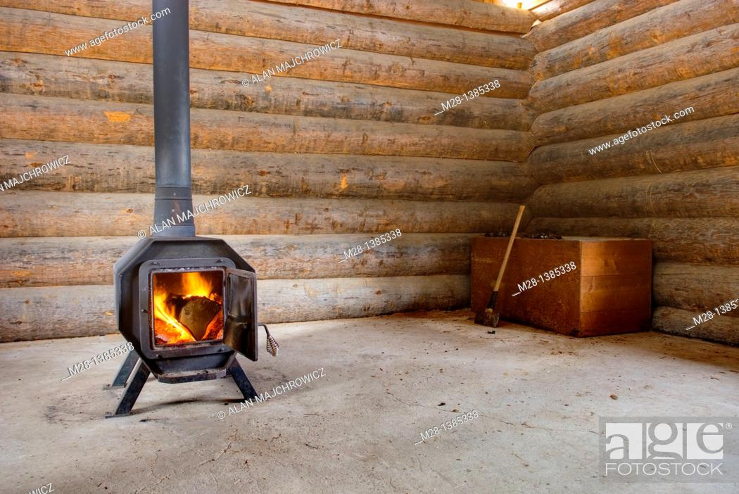 Stock Photo: Wood Stove in log warming hut.