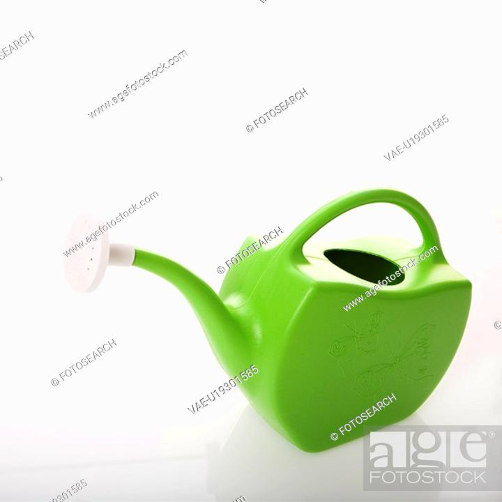 Stock Photo: Green plastic watering can.