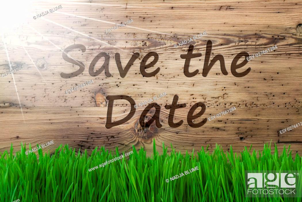 Stock Photo: English Text Save The Date. Spring Season Greeting Card. Sunny Aged Wooden Background With Gras.