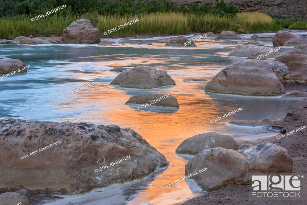 Stock Photo: Little Colorado River- mineral-laden water with canyon wall reflections at dawn, Grand Canyon National Park, Arizona, USA.