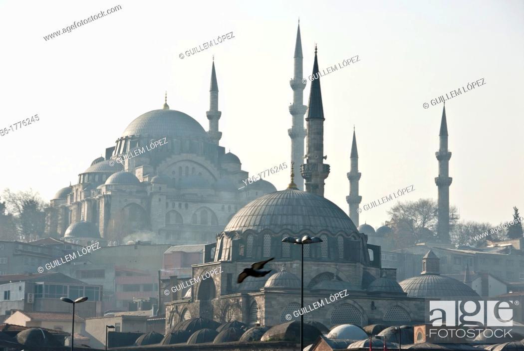 Stock Photo: View of the Yeni and Suleymaniye Mosques from the Galata bridge, Istanbul, Turkey.